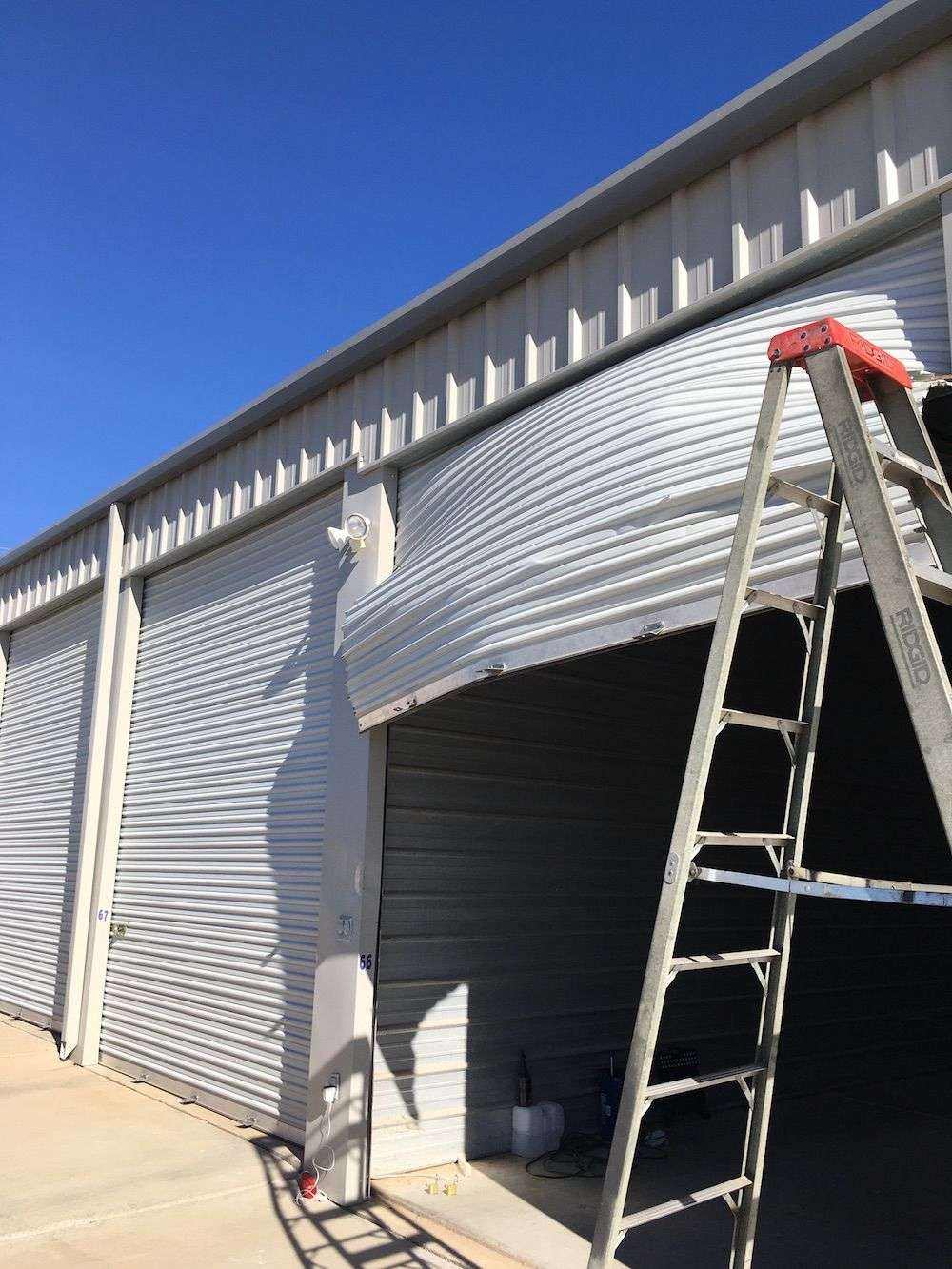 damaged-commercial-door-panels-Emergency Garage Doors Repair